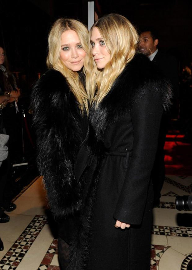 Ashley Olsen and Mary-Kate Olsen attend the WWD @ 100 Anniversary Party at Cipriani 42nd Street on November 2, 2010 in New York City.