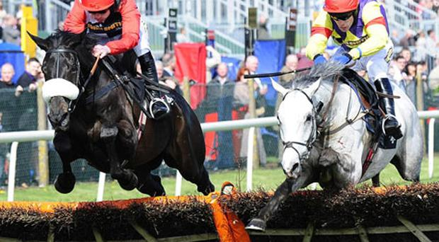 Ruby Walsh steers Big Buck's to victory in the Liverpool Hurdle from Grand Crus (Tom Scudamore). Photo: PA