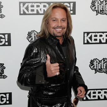 Vince Neil had a seven month relationship with Alicia Jacobs