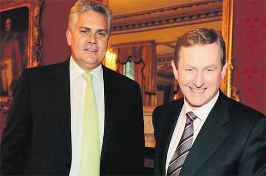 Gavin O'Reilly, group chief executive officer INM, with Taoiseach Enda Kenny