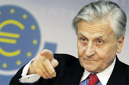 Jean-Claude Trichet, president of the European Central Bank, answers reporters' questions during his monthly news conference at the ECB headquarters in Frankfurt yesterday