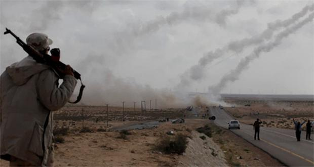 Rebel fighters fire rockets from the desert east of Brega. Photo: Reuters