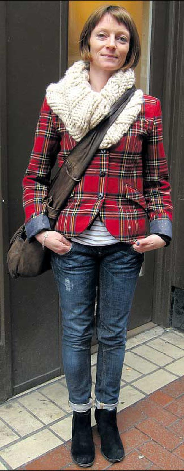 Aisling Butler. Aisling's chunky snood, washed leather bag, polka-dot cuffs and Breton tee give traditional tartan an inspirational shake-up