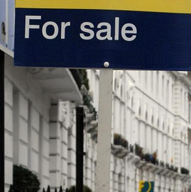Frederick Harris is accused of removing a 'for sale' sign from a house and squatting in the 300,000 pound home