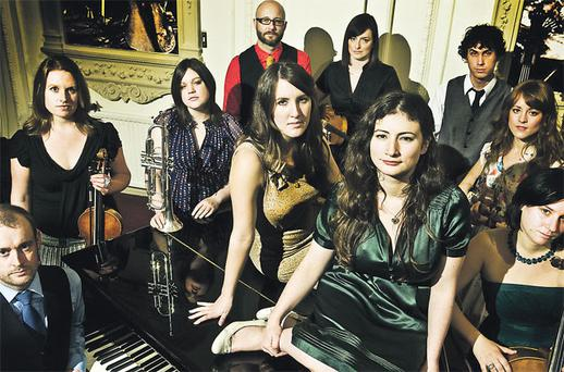 Something old, something new: The Unthanks, with Rachel on top of the piano in green and Becky to her left, play folk music with a modern twist