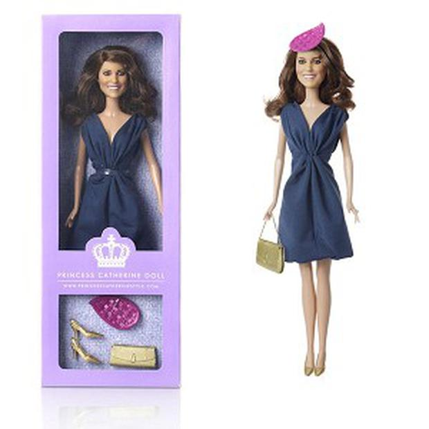The Princess Catherine Doll, which is fashioned to resemble Kate Middleton, right down to the Eaton clutch bag and fascinator