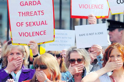 SPEAK NO EVIL: Women stand in solidarity with the women at the centre of the 'rape tape' garda scandal outside the Dail on Friday. Photo: Damien Eagers