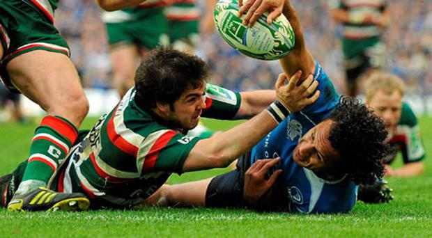 Horacio Agulla of Leicester can't stop Isa Nacewa from going over the line for Leinster's try on Saturday.