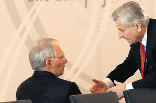 Number-crunchers: Jean-Claude Trichet, ECB president, right, chats to German Finance Minister Wolfgang Schaueble
