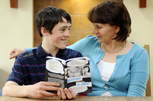 All change: Nuala Deering pictured at home with son Matthew. She has seen huge improvements in him after following Patrick McKeown's techniques.