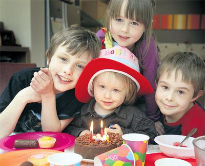 Great expectations: Evan, Ethan, Erica and Ronan Wells. Their mum Alison thinks that children would be a bit disgruntled if there weren't any party bags.