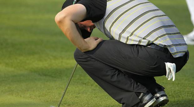 Rory's quest for Masters glory unravelled spectacularly with a wayward tee-shot on the 10th. Photo: Reuters