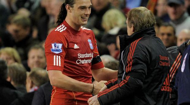 Liverpool manager Kenny Dalglish shows his appreciation for Andy Carroll's performance after his two goals helped the Anfield club to victory last night. Photo: Getty Images