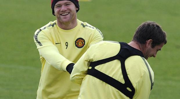 Wayne Rooney and Michael Owen react during Manchester United's training session ahead of tonight's Champions League semi-final. Photo: Reuters
