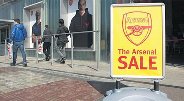 A sign outside the Arsenal club shop yesterday on the day Stan Kroenke confirmed his takeover of the club.