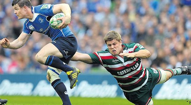 Brian O'Driscoll, pictured breaking away during the quarter-final clash with Leicester, knows the value of winning a second Heineken Cup trophy.