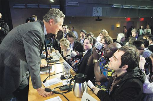 International Monetary Fund's economic counsellor Olivier Blanchard (left) answering a question after the World Economic Outlook news conference at the IMF headquarters in Washington yesterday