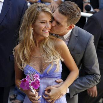 Michael Buble kisses Luisana Lopilato after their civil wedding ceremony in Buenos Aires