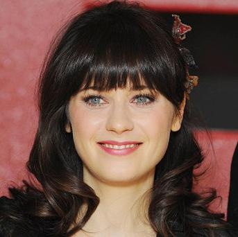 Zooey Deschanel is the 'musical narrator' for the latest Winnie the Pooh film