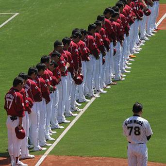 Rakuten Golden Eagles, a Japanese team based in Sendai, observe a moment of silence for victims of the March 11 earthquake
