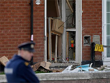 The damaged front door of a home in Clondalkin, west Dublin, where the bomb attack took place. Photo: PA