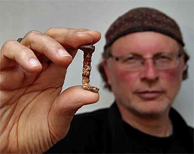 Film director Simcha Jacobovici displays a nail at a press conference in Jerusalem, which he claims was used in the crucifixion of Christ. Photo: PA