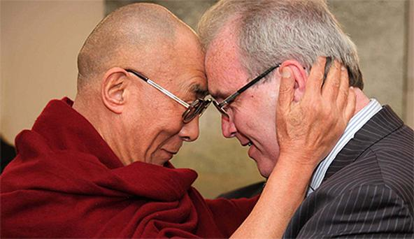 The Dalai Lama is greeted by close friend Richard Moore of Children in Crossfire at Dublin Airport yesterday