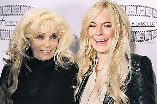 Lindsay Lohan poses with Victoria Gotti at a news conference to promote 'Gotti: Three Generations' in New York, yesterday