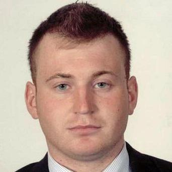 Detectives investigating the murder of Constable Ronan Kerr are carrying out searches in the town where he died