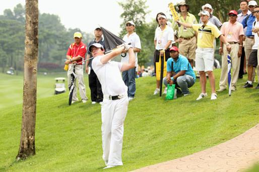 Rory in action in Malaysia. Photo: Getty Images