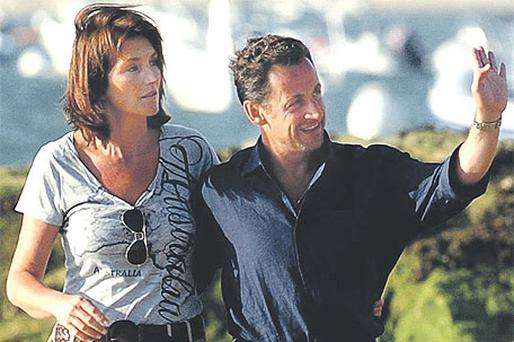 Cecilia Sarkozy and her then husband Nicolas Sarkozy walking on a beach in Arcachon, south-west France, in August 2006