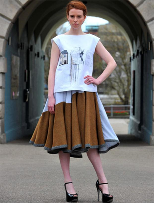 Niamh O'Toole models one of Ruth Duignan's ghost estate-inspired designs at Collins Barracks in Dublin yesterday