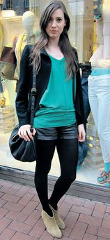 Paloma plays down her leather shorts with a colour pop top and discreet Marc Jacobs bag.