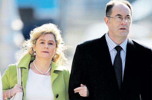 Mary O'Toole, from Tullamore, Co Offaly, leaves court yesterday with husband Eamon. Photo: COLLINS