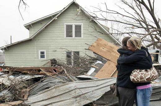DEVASTATION: Distressed residents embrace in Mapleton, Iowa. Photo: AP