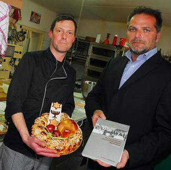 Austrian pastry shop owner Manfred Klaschka (left) and member of the Mauthausen Committee, Willi Mernyi (AP)