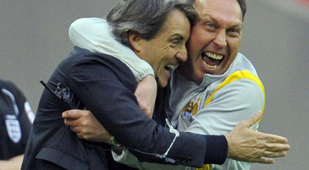 David Platt hugs Manchester City manager Roberto Mancini after their FA Cup semi-final victory at Wembley.