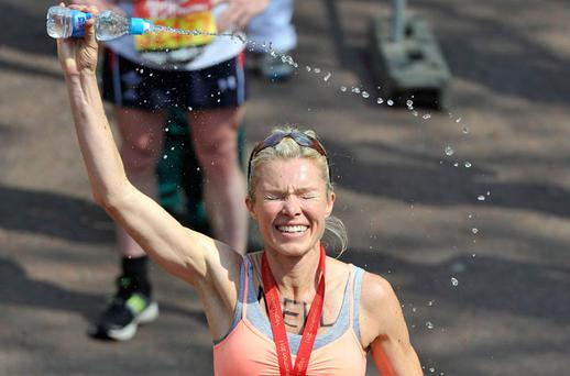Nell McAndrew cools down after finishing the London Marathon in which 35,303 runners started. Photo: Getty Images