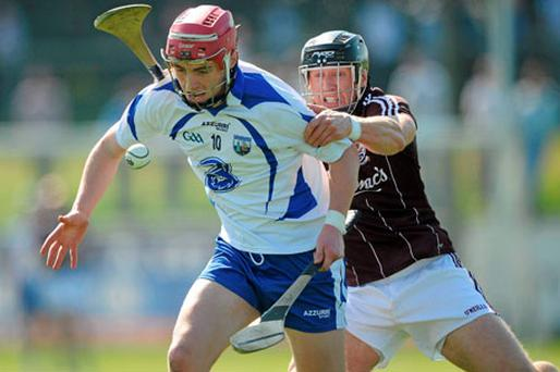 Waterford's Pauric Mahony attempts to get away from Galway's Damien Joyce during their Allianz NHL Division 1 game in Walsh Park yesterday. Photo: Stephen McCarthy / Sportsfile