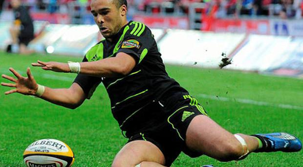 Simon Zebo dives over to score Munster's try at Parc Y Scarlets on Saturday night. Photo: Ian Cook / Sportsfile