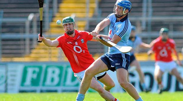 Brian Murphy attempts to block Conal Keaney