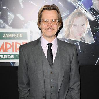 Gary Oldman says he finds his grey costumes very drab