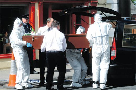 Gardai removing the body of Diane Burroughs who was found dead in her apartment in Mountrath, Co Laois, on Saturday evening
