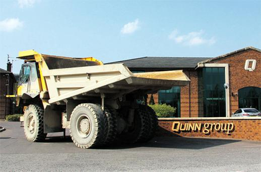 An abandoned dump truck blocks the entrance to the Quinn Group HQ in Fermanagh yesterday