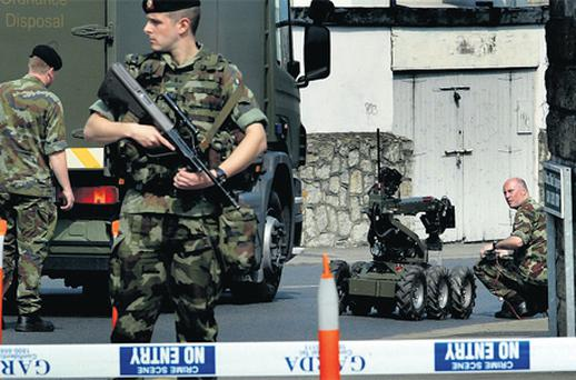 Members of the Army bomb disposal unit in Dun Laoghaire, Co Dublin, yesterday