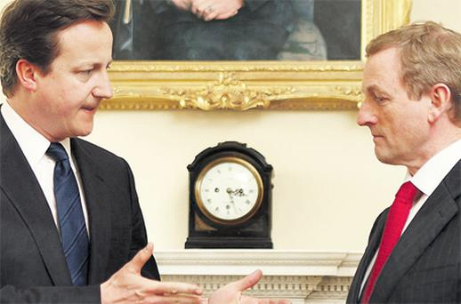 Taoiseach Enda Kenny (right) meets his British counterpart David Cameron under a portrait of former prime minister Margaret Thatcher at 10 Downing Street, London, yesterday