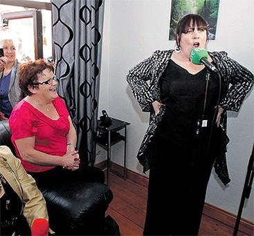 Mary Byrne sings in Paul and Bernie Martin's front room in Ballyfermot