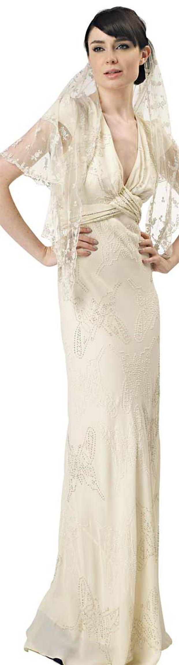 A Libelula bridal dress. The label is rumoured to be behind Kate's gown.
