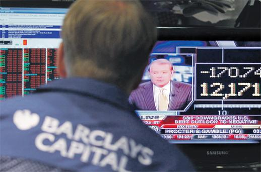 A television displays the Dow shortly after its opening on the floor of the New York Stock Exchange yesterday. Photo: Reuters