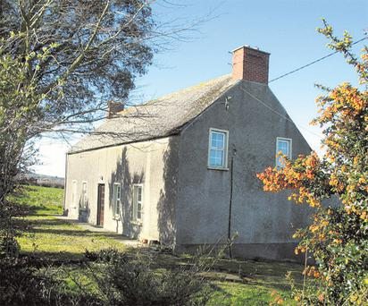 The residence is a two-storey, stone-built farmhouse that needs substantial modernisation